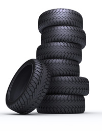 A photo of a stack of new tyres